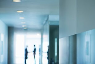 Distant view of greeting in modern office
